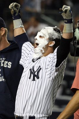 NEW YORK - SEPTEMBER 08:  Nick Swisher #33 of the New York Yankees celebrates his game winning walk off home run against the Tampa Bay Rays after receiving a shaving cream pie from teammate A.J. Burnett (not pictured) on September 8, 2009 at Yankee Stadiu