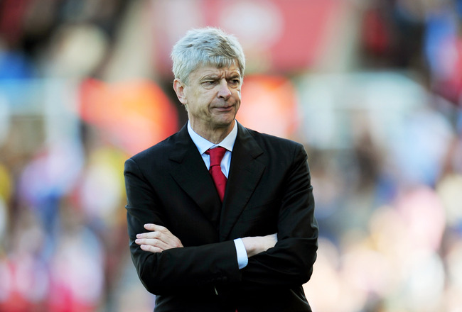 STOKE ON TRENT, ENGLAND - MAY 08:  A dejected Arsene Wenger the Arsenal manager looks on as his team head towards a 3-1 defeat during the Barclays Premier League match between Stoke City and Arsenal at the Britannia Stadium on May 8, 2011 in Stoke on Tren
