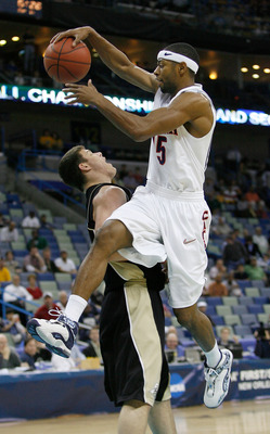 NEW ORLEANS - MARCH 16:  Mustafa Shakur #15 of the Arizona Wildcats and Chris Kramer #3 of the Purdue Boilermakers clash during the first half of round one of the NCAA Men's Basketball Tournament at the New Orleans Arena on March 16, 2007 in New Orleans,