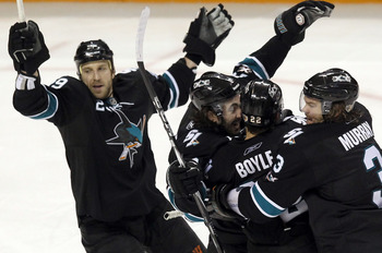 SAN JOSE, CA - APRIL 29:  Benn Ferriero #78 of the San Jose Sharks is congratulated by teammates after he scored the winning goal in overtime of their game against the Detroit Red Wings in Game One of the Western Conference Semifinals during the 2011 NHL