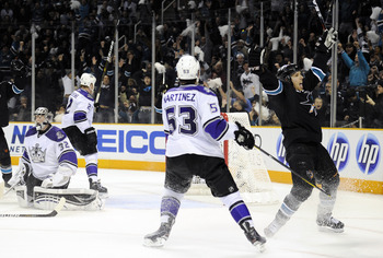 SAN JOSE, CA - APRIL 14: Joe Pavelski #8 of the San Jose Sharks celebrates after scoring the winning goal in overtime against the Los Angeles Kings in Game One of the Western Conference Quarterfinals  during the 2011 NHL Stanley Cup Playoffs at the HP Pav