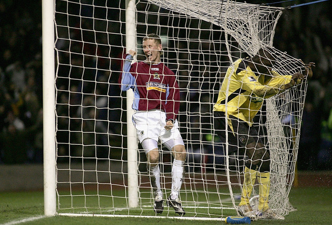 BURNLEY, ENGLAND - JANUARY 18: Lee Roche (left) of Burnley celebrates the own goal scored by Djimi Traore of Liverpool during the FA Cup third round match between Burnley and Liverpool at Turf Moor on January 18, 2005 in Burnley, England.  (Photo by Micha