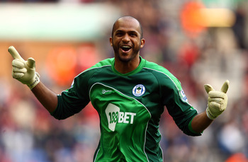 WIGAN, ENGLAND - MARCH 19:  Wigan goal keeper Ali Al Habsi celebrates the winning goal during the Barclays Premier League match between Wigan Athletic and Birmingham City at the DW Stadium on March 19, 2011 in Wigan, England.  (Photo by Richard Heathcote/