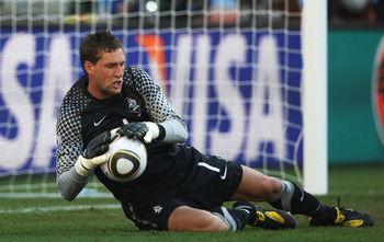 DURBAN, SOUTH AFRICA - JUNE 19:  Maarten Stekelenburg of the Netherlands saves a shot during the 2010 FIFA World Cup South Africa Group E match between Netherlands and Japan at Durban Stadium on June 19, 2010 in Durban, South Africa.  (Photo by Steve Haag