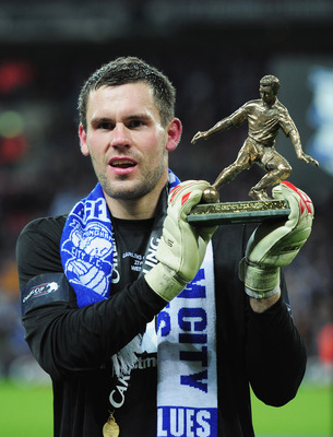 LONDON, ENGLAND - FEBRUARY 27: Man of the Match Ben Foster of Birmingham City poses with his award after the Carling Cup Final between Arsenal and Birmingham City at Wembley Stadium on February 27, 2011 in London, England.  (Photo by Shaun Botterill/Getty