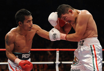 LAS VEGAS - JUNE 28:  Manny Pacquiao of the Philippines triese a left hook to David Diaz during the fourth round of the WBC Lightweight Championship at the Mandalay Bay Events Center on June 28, 2008 in Las Vegas, Nevada.  Pacquiao would go on to win in a