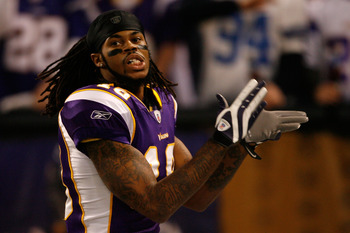 MINNEAPOLIS - JANUARY 17:  Wide receiver Sidney Rice #18 of the Minnesota Vikings celebrates while playing against the Dallas Cowboys during the first half of the NFC Divisional Playoff Game at Hubert H. Humphrey Metrodome on January 17, 2010 in Minneapol