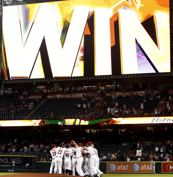 HOUSTON - MAY 11:  The Houston Astros celebrate a 4-3 win over the Cincinnati Reds after a Hunter Pence #9 of the Houston Astros  doubles to left field scoring J.R. Towles from first base at Minute Maid Park on May 11, 2011 in Houston, Texas.  (Photo by B