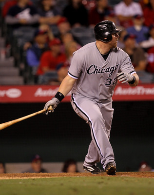 ANAHEIM, CA - MAY 11: Adam Dunn #32 of the Chicago White Sox hits a double in the tenth inning against the Los Angeles Angels of Anaheim on May 11, 2011 at Angel Stadium in Anaheim, California.  The White Sox won 6-4 in ten innings.  (Photo by Stephen Dun