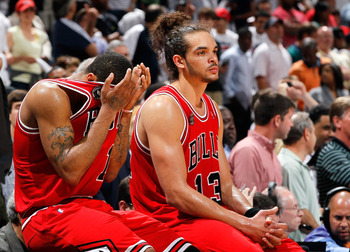 ATLANTA, GA - MAY 08:  Derrick Rose #1 and Joakim Noah #13 of the Chicago Bulls react as they wait to come back in after a timeout against the Atlanta Hawks in the final minutes of their 100-88 loss in Game Four of the Eastern Conference Semifinals in the