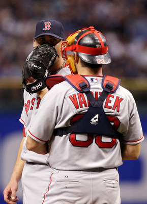 ST PETERSBURG, FL - OCTOBER 18:  Starting pitcher Josh Beckett #19 of the Boston Red Sox talks with his catcher Jason Varitek #33 against the Tampa Bay Rays in game six of the American League Championship Series during the 2008 MLB playoffs on October 18,