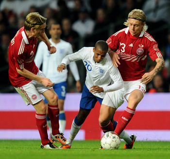 COPENHAGEN, DENMARK - FEBRUARY 09:  Ashley Young of England is challenged by Simon Kjaer of Denmark during the International Friendly match between Denmark and England at Parken Stadium on February 9, 2011 in Copenhagen, Denmark.  (Photo by Mike Hewitt/Ge