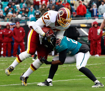 JACKSONVILLE, FL - DECEMBER 26:  Chris Cooley #47 of the Washington Redskins is tackled by Don Carey #22 of the Jacksonville Jaguars  during the game at EverBank Field on December 26, 2010 in Jacksonville, Florida.  (Photo by Sam Greenwood/Getty Images)