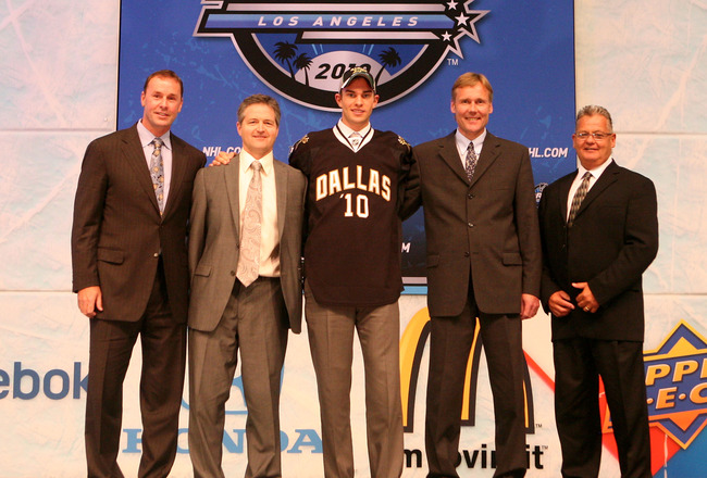 LOS ANGELES, CA - JUNE 25:  Jack Campbell, drafted 11th overall by the Dallas Stars, poses on stage with team personnel during the 2010 NHL Entry Draft at Staples Center on June 25, 2010 in Los Angeles, California.  (Photo by Bruce Bennett/Getty Images)