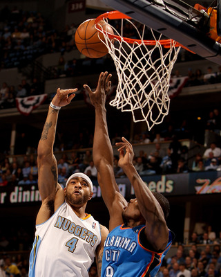 DENVER, CO - APRIL 25:  Kenyon Martin #4 of the Denver Nuggets scores on Serge Ibaka #9 of the Oklahoma City Thunder in Game Four of the Western Conference Quarterfinals in the 2011 NBA Playoffs at Pepsi Center on April 25, 2011 in Denver, Colorado. NOTE