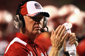 RALEIGH, NC - SEPTEMBER 16:  Head coach Tom O'Brien of the North Carolina State Wolfpack cheers on his team against the Cincinnati Bearcats during their game at Carter-Finley Stadium on September 16, 2010 in Raleigh, North Carolina.  (Photo by Streeter Le