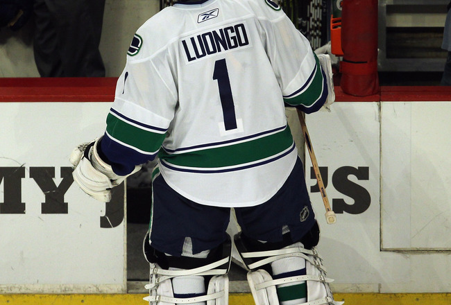 CHICAGO, IL - APRIL 24: Roberto Luongo #1 of the Vancouver Canucks skates off the ice after giving up the winning goal against the Chicago Blackhawks in Game Six of the Western Conference Quarterfinals during the 2011 NHL Stanley Cup Playoffs at the Unite