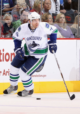 GLENDALE, AZ - MARCH 08:  Mikael Samuelsson #26 of the Vancouver Canucks skates with the puck during the NHL game against the Phoenix Coyotes at Jobing.com Arena on March 8, 2011 in Glendale, Arizona. The Canucks defeated the Coyotes 4-3 in overtime.  (Ph