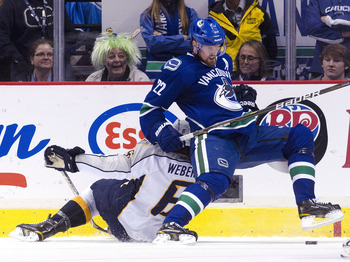 VANCOUVER, CANADA - MAY 7: Daniel Sedin #22 of the Vancouver Canucks gets hauled down by Shea Weber #6 of the Nashville Predators during the second period in Game Five of the Western Conference Semifinals during the 2011 NHL Stanley Cup Playoffs on May 07