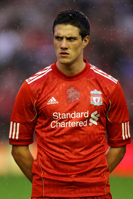 LIVERPOOL, ENGLAND - AUGUST 19:  Martin Kelly of Liverpool looks on prior to the UEFA Europa League play-off first leg match beteween Liverpool and Trabzonspor at Anfield on August 19, 2010 in Liverpool, England.  (Photo by Alex Livesey/Getty Images)