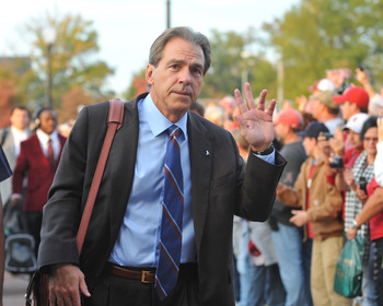 TUSCALOOSA, AL - NOVEMBER 13: Coach Nick Saban of the Alabama Crimson Tide enters the stadium before play against the Mississippi State Bulldogs November 13, 2010 at Bryant-Denny Stadium in Tuscaloosa, Alabama.  (Photo by Al Messerschmidt/Getty Images)