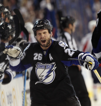 TAMPA, FL - MAY 04:  Martin St. Louis #26 of the Tampa Bay Lightning celebrates his goal at 16:52 of the third period against the Washington Capitals in Game Four of the Eastern Conference Semifinals during the 2011 NHL Stanley Cup Playoffs at the St Pete
