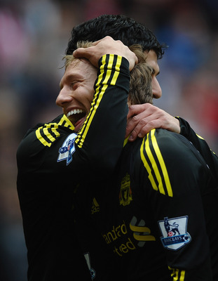 SUNDERLAND, ENGLAND - MARCH 20: Luis Suarez of Liverpool celebrates his goal with Lucas Leiva during the Barclays Premier League match between Sunderland and Liverpool at the Stadium of Light on March 20, 2011 in Sunderland, England.  (Photo by Laurence G