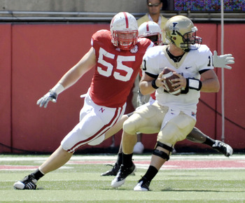 LINCOLN, NEBRASKA - SEPTEMBER 11: Idaho Vandals quarterback Nathan Enderle #10 tries to elude over Nebraska Cornhuskers defensive tackle Baker Steinkuhler #55 during first half action of their game at Memorial Stadium on September 4, 2010 in Lincoln, Nebr
