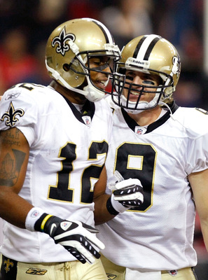 ATLANTA - DECEMBER 13:  Marques Colston #12 and quarterback Drew Brees #9 of the New Orleans Saints celebrate Colston's 3-yard touchdown reception in the second quarter against the Atlanta Falcons at Georgia Dome on December 13, 2009 in Atlanta, Georgia.