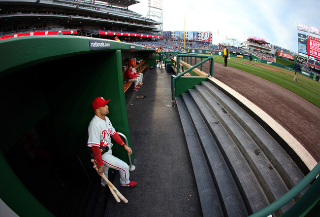 WASHINGTON, DC - APRIL 13:  Placido Polanco #27 of the Philadelphia Phillies enters the dugout before the start of the Phillies game against the Washington Nationals at Nationals Park on April 13, 2011 in Washington, DC.  (Photo by Rob Carr/Getty Images)