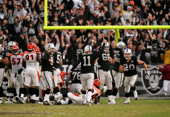 OAKLAND, CA - NOVEMBER 22:  Sebastian Janikowski #11 of the Oakland Raiders celebrates after he kicked the winning field goal with less than a minute to play against the Cincinnati Bengals at Oakland-Alameda County Coliseum on November 22, 2009 in Oakland