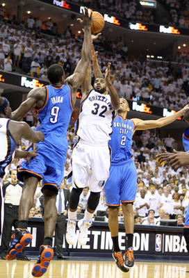 MEMPHIS, TN - MAY 07: O.J. Mayo #32 of the  Memphis Grizzlies shoots the ball while defended by  Serge Ibaka #9 and Thabo Sefolosha #2 of the Oklahoma City Thunder in Game Three of the Western Conference Semifinals in the 2011 NBA Playoffs at FedExForum o