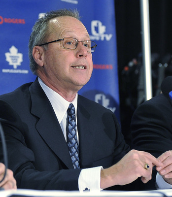 TORONTO - NOVEMBER 29:   MLSE President and CEO Richard Peddie and Brian Burke attend a press conference announcing Burke as the teams new General Manager November 29, 2008 at the Air Canada Centre in Toronto, Ontario, Canada. (Photo by Brad White/Getty I