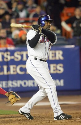 NEW YORK - APRIL 11: Carlos Delgado #21 of the New York Mets swings at the pitch during the MLB game against the Philadelphia Phillies at Shea Stadium on April 11, 2007 in the Flushing neighborhood of the Queens borough of New York City. (Photo by Chris M