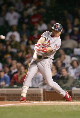 CHICAGO - SEPTEMBER 15: Larry Walker #33 of the St. Louis Cardinals swings at the pitch during the game against the Chicago Cubs  on September 15, 2005 at Wrigley Field in Chicago, Illinois. The Cardinals won 6-1. (Photo by Jonathan Daniel/Getty Images)