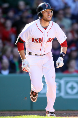 BOSTON, MA - MAY 01:  Jed Lowrie #12 of the Boston Red Sox heads for first after he hit a triple in the bottom of the ninth inning against the Seattle Mariners on May 1, 2011 at Fenway Park in Boston, Massachusetts. Lowrie would score on a hit by Carl Cra