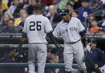 DETROIT, MI - MAY 02: Curtis Granderson #14 of the New York Yankees congratulates Eduardo Nunez after driving in a run in the second inning while playing the New York Yankees at Comerica Park on May 2, 2011 in Detroit, Michigan. New York won the game 5-3.