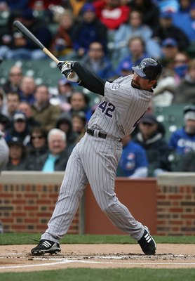CHICAGO - APRIL 15: Todd Helton of the Colorado Rockies, wearing a #42 jersey on Jackie Robinson Day, swings the bat against the Chicago Cubs on April 15, 2009 at Wrigley Field in Chicago, Illinois. The Rockies defeated the Cubs 5-2. (Photo by Jonathan Da