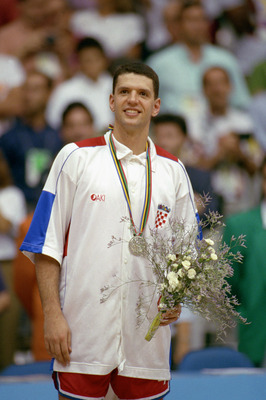 BARCELONA, SPAIN - AUGUST 8:  Drazen Petrovic #4 of Croatia is awarded with the silver medal after the game against the United States in the 1992 Olympic games on August 8, 1992 in Barcelona, Spain. The 'Dream Team' defeated Croatia 103-70. NOTE TO USER: