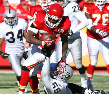 KANSAS CITY, MO - JANUARY 02:  Running back Jamaal Charles #25 of the Kansas City Chiefs is tackled by linebacker Rolando McClain #55 of the Oakland Raiders in a game at Arrowhead Stadium on January 2, 2011 in Kansas City, Missouri.  (Photo by Tim Umphrey