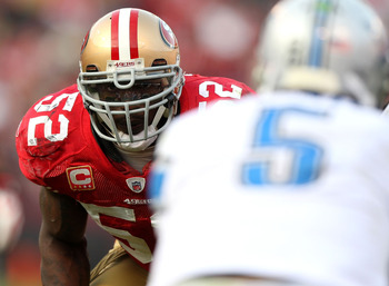 SAN FRANCISCO - DECEMBER 27: Patrick Willis #52 of the San Francisco 49ers eyes quarterback Drew Stanton #5 of the Detroit Lions before a play during an NFL game at Candlestick Park on December 27, 2009 in San Francisco, California.  (Photo by Jed Jacobso