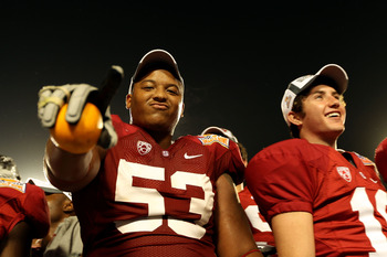 MIAMI, FL - JANUARY 03:  Derek Hall #53 of the Stanford Cardinal celebrates after Stanford won 40-12 against the Virginia Tech Hokies during the 2011 Discover Orange Bowl at Sun Life Stadium on January 3, 2011 in Miami, Florida.  (Photo by Mike Ehrmann/Ge