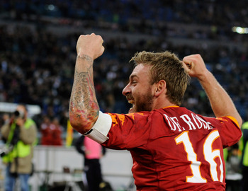 ROME - NOVEMBER 07:  Daniele De Rossi of AS Roma celebrates winning the match against Lazio during the Serie A match between Lazio and Roma at Stadio Olimpico on November 7, 2010 in Rome, Italy.  (Photo by Claudio Villa/Getty Images)
