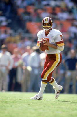 1984:  Joe Theismann #7 of the Washington Redskins moves as he looks to pass during a 1984 NFL season game. ( Photo by: Scott Cunningham/Getty Images)