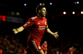 LIVERPOOL, ENGLAND - NOVEMBER 04:  Steven Gerrard of Liverpool celebrates scoring an equalising goal during the UEFA Europa League Group K match beteween Liverpool and SSC Napoli at Anfield on November 4, 2010 in Liverpool, England.  (Photo by Clive Bruns