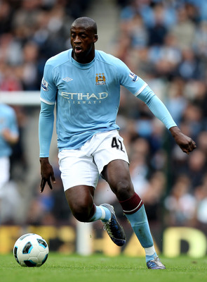 MANCHESTER, ENGLAND - SEPTEMBER 25:   Yaya Toure of Manchester City in action during the Barclays Premier League match between Manchester City and Chelsea at the City of Manchester Stadium on September 25, 2010 in Manchester, England.  (Photo by Michael S