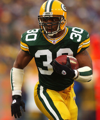 GREEN BAY, WI - DECEMBER 28:  Running back Ahman Green #30 of the Green Bay Packers runs the football during the game against the Denver Broncos on December 28, 2003 at Lambeau Field in Green Bay, Wisconsin. The Packers defeated the Broncos 31-3 to win th