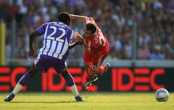 TOULOUSE, FRANCE - AUGUST 15:  Javier Mascherano of Liverpool battles with Moussa Sissoko of Toulouse during the Champions League first leg of the third qualifying round match between Toulouse and Liverpool at the Stade Municipal Haute-Garonne on August 1
