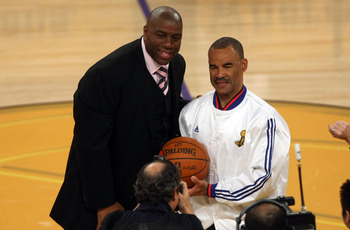 LOS ANGELES, CA - JUNE 04:  NBA legend Magic Johnson presents the game ball to referee Dan Crawford before Game One of the 2009 NBA Finals between the Los Angeles Lakers and the Orlando Magic in at Staples Center on June 4, 2009 in Los Angeles, California