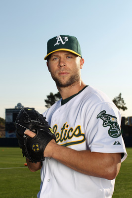 PHOENIX, AZ - FEBRUARY 24:  Rich Harden #18 of the Oakland Athletics poses for a portrait during media photo day at Phoenix Municipal Stadium on February 24, 2011 in Phoenix, Arizona.  (Photo by Ezra Shaw/Getty Images)